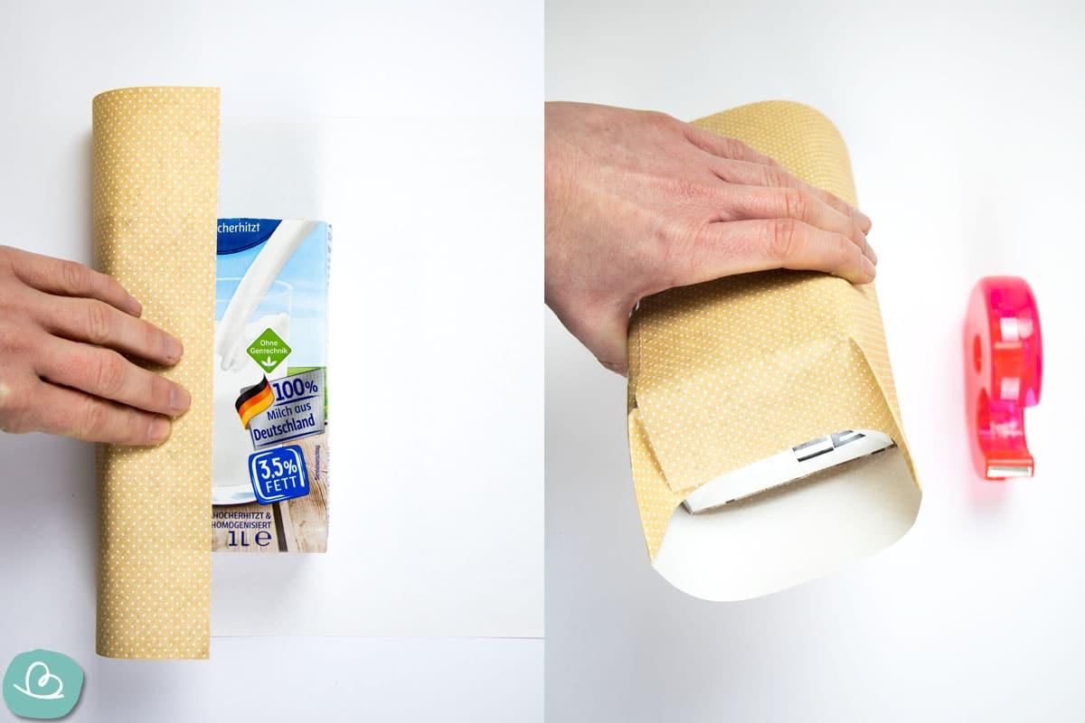 Milchkarton mit Papier verpacken