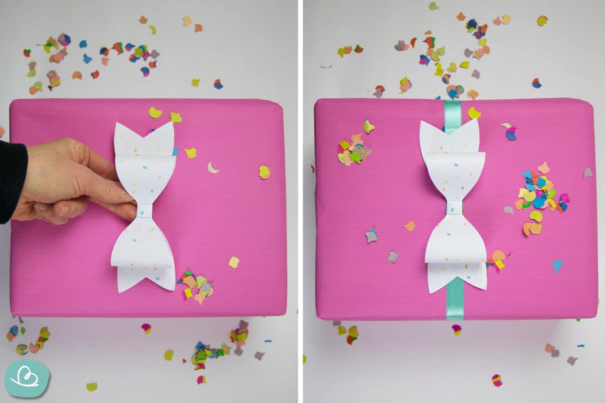 Papierschleife auf Geschenk