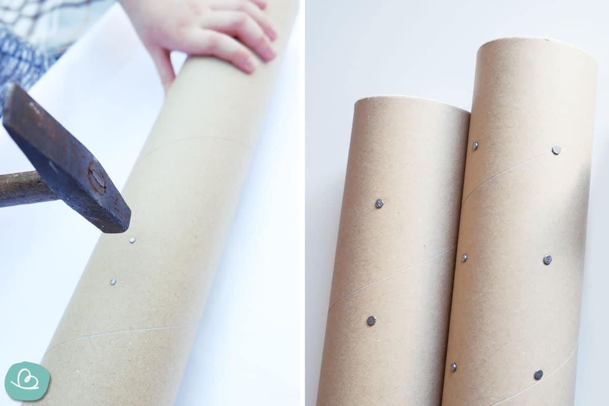 Nägel einschlagen in eine Papprolle