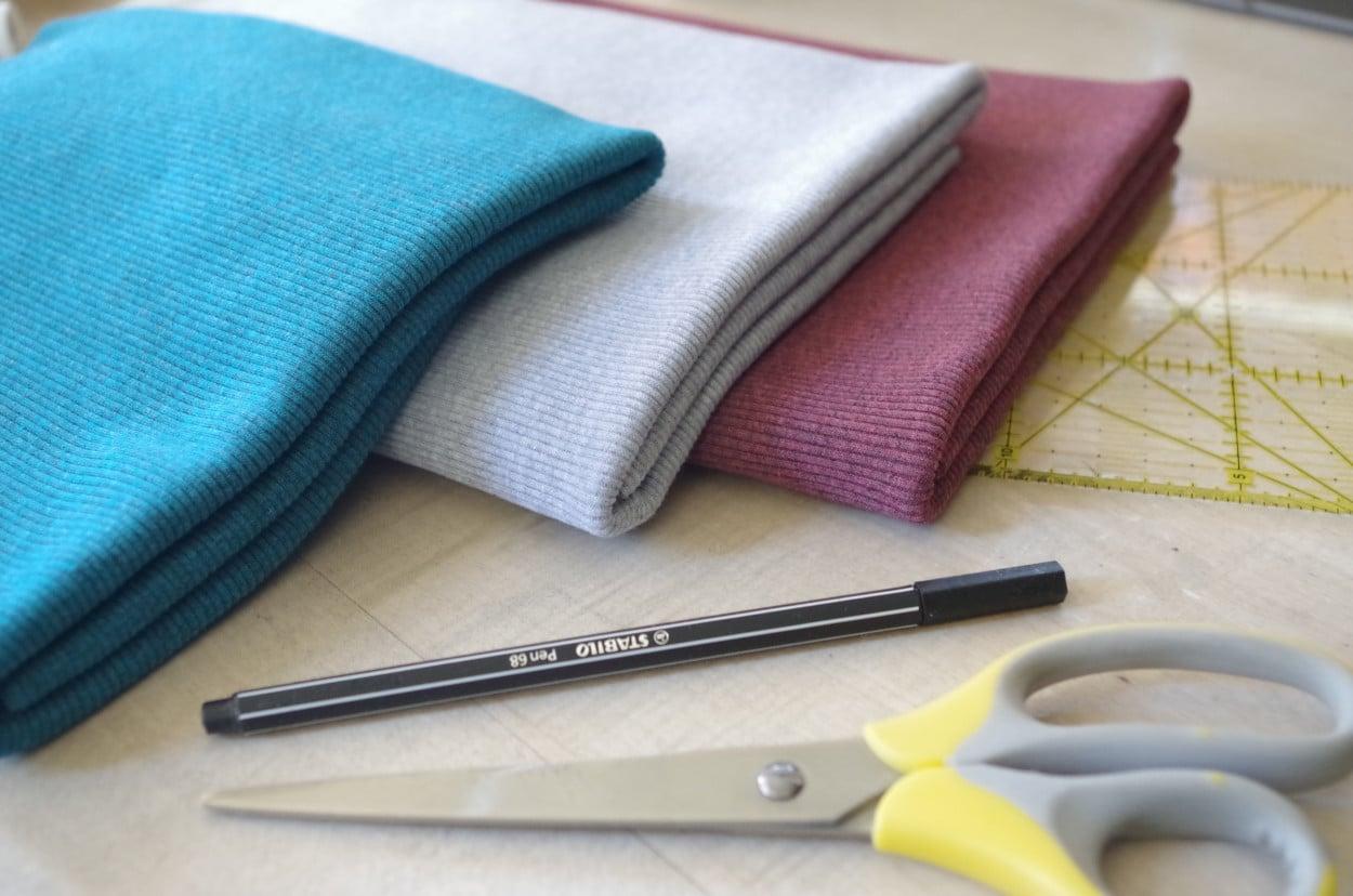 Bündchenstoff Schere und Stift