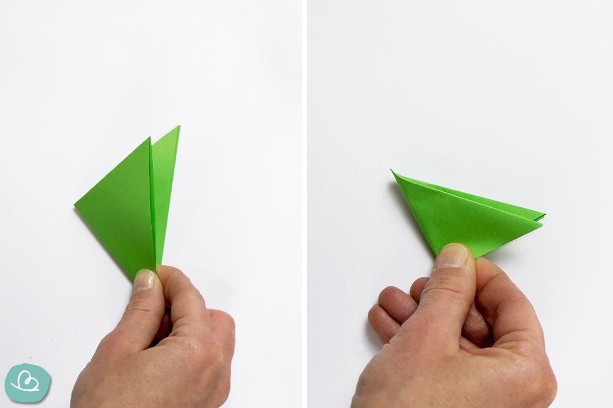 grünes Papier gefaltet
