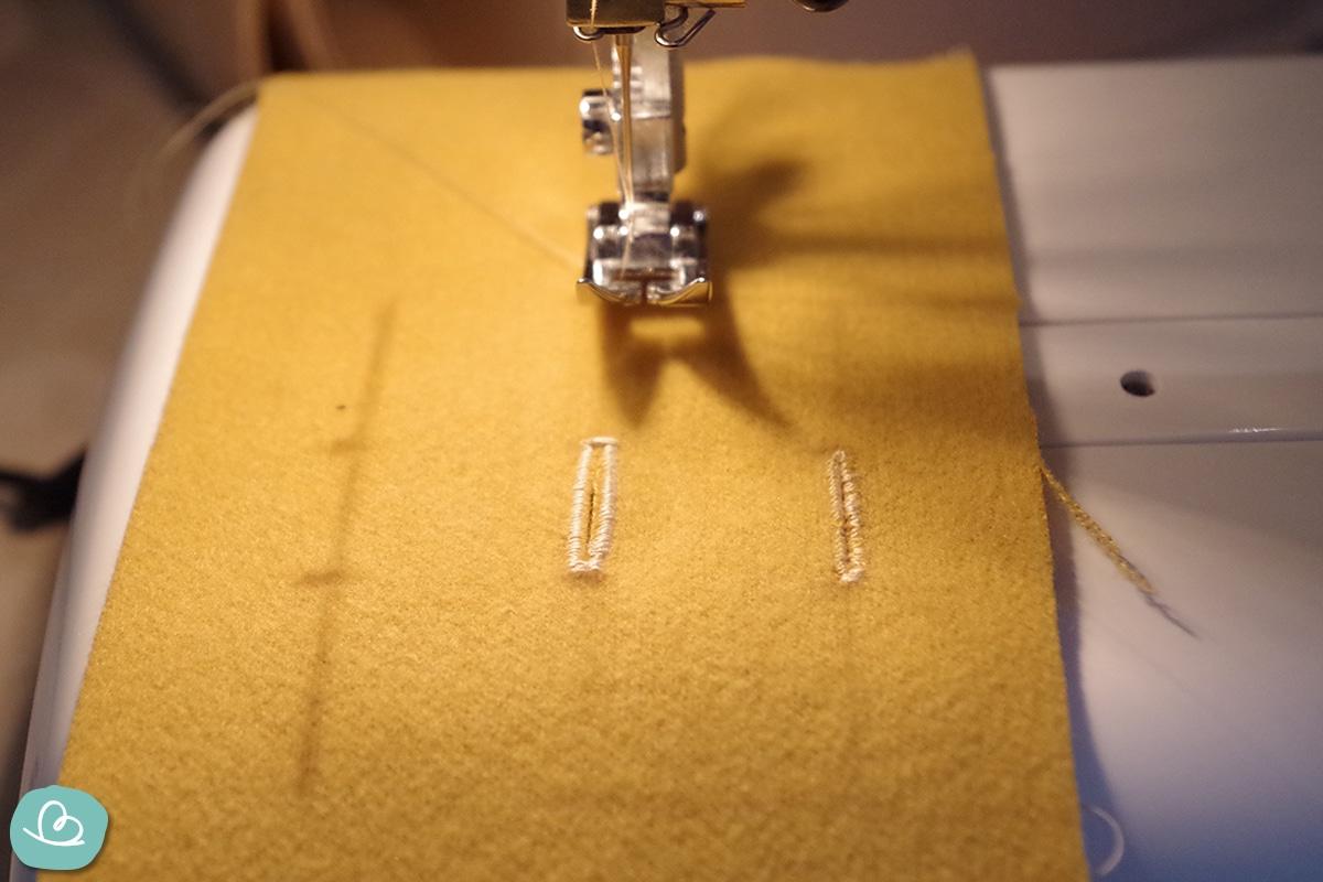 Knopfloch Nähmaschine und Stoff