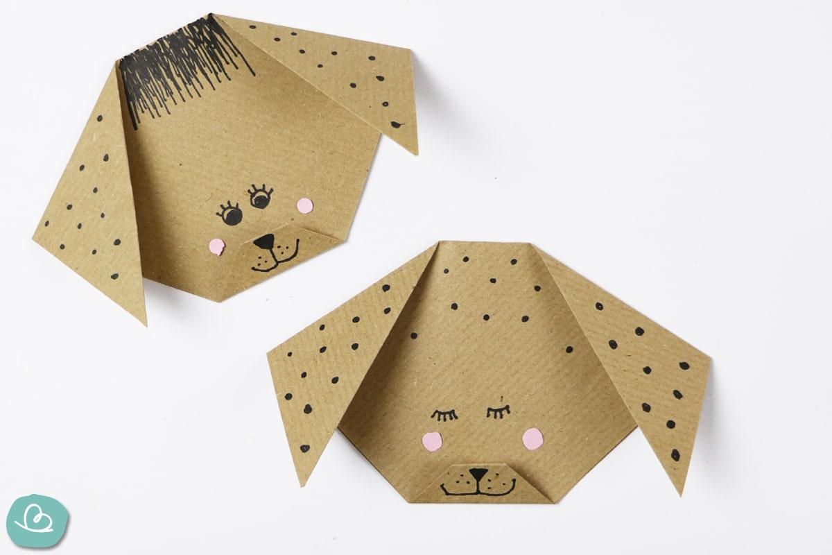 Hundeköpfe aus Papier mit Gesicht